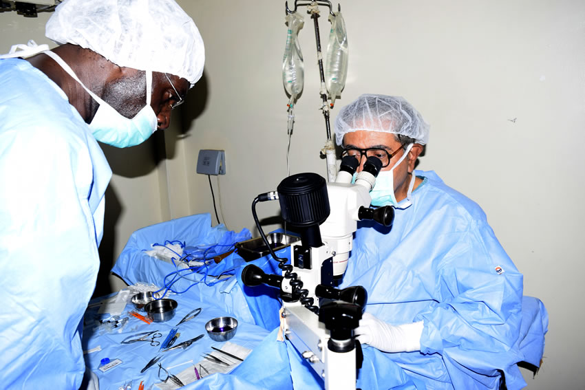 Picture of Honorary Rotarian Ophthalmologist Dr Mukesh Joshi performing a cataract surgery.